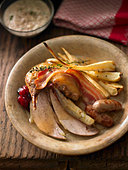 Roast pheasant with bacon, sausages and bread sauce (UK) - Stock Image - BJKG23