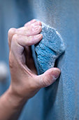 Close up of climber gripping rock wall - Stock Image - CT3CNC