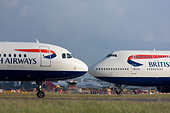 Short-haul and long-haul British Airways planes taxiing for departure at London Heathrow Airport, United Kingdom - Stock Image - B7DNHW