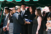 Tucson, Arizona, USA. 24th May, 2014. MELINDA BARRERAS (ed. note: without sunglasses), the wife of Command Sgt. Maj. MARTIN BARRERAS, receives the flag from her husband's casket during his interrment in Tucson, Ariz. Barreras was wounded earlier in May after his unit came under fire in Herat Province, Afghanistan and died May 13, 2014 in Texas. Barreras is the most recent U.S. serviceman killed as a result of enemy action in Afghanistan. © Will Seberger/ZUMAPRESS.com/Alamy Live News - Stock Image - E16PH9