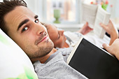Guy and girl reading - Stock Image - CMRYMY