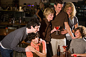 Young friends hanging out and drinking at bar together - Stock Image - B720G4