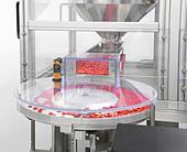 Machine Sorting Medicine Pills Before Filling - Stock Image - B2PABR