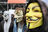 Protestors wearing Guy Fawkes masks of the Anonymous movement, based on a character in the film V for Vendetta, Paris, France - Stock Image - D1EB2G