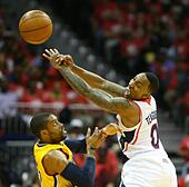 Atlanta, Georgia, USA. 1st May, 2014. The Atlanta Hawks' Jeff Teague, right, deflects a pass intended for the Indiana Pacers' C.J. Watson in the first half of Game 6 of the NBA Eastern Conference quarterfinals at Philips Arena in Atlanta, Thursday, May 1, 2014. (Curtis Compton/Atlanta Journal-Constitution/MCT/Alamy Live News) - Stock Image - E04C5D