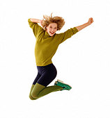 Young woman jumping athletically, wearing green sweater and tight shorts. - Stock Image - BBM1YR