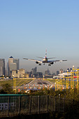 British Airways regional airliner landing at London City Airport, England, UK - Stock Image - CYHHRP