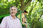 Man smiling outdoors - Stock Image - DRC829