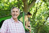 Man smiling outdoors - Stock Image - DRC829