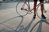 Cyclist with bike - Stock Image - BWB3C6