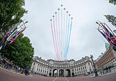 London, UK. 13th June, 2015. Flypast by the RAF Red Arrows over Admiralty Arch at 1.00pm after HRH The Queen takes the salute and inspects the parade at Trooping the Colour, The Queen's Birthday Parade. Further aircraft due to flypast were cancelled as a result of weather conditions. © Malcolm Park editorial/Alamy Live News - Stock Image - ETF3G3
