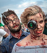 """Warsaw, Poland. 28th June 2015. Participants of the 9th Zombie Walk in Warsaw. During annual event people dressed up in zombie costumes and makes their way around city centre, scares residents and """"fights"""" with defenders of the city. © kpzfoto/Alamy Live News - Stock Image - EWK26J"""