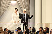 Paris, France. 07th July, 2015. German designer Karl Lagerfeld acknowledges the applause with US model Kendall Jenner after his Fall/Winter 2015/2016 Haute Couture collection for Chanel during the Paris Fashion Week, in Paris, France, 07 July 2015. The presentation of the Haute Couture collections runs from 05 to 09 July. © dpa picture alliance/Alamy Live News - Stock Image - EX578Y