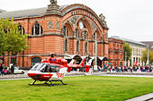 Emergency helicopter landed on the grass outside Bremen Hauptbahnhof. - Stock Image - E6RARN