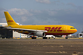 DHL European Air Transport - EAT Airbus A300B4-103(F) taxiing for departure at London Heathrow, United Kingdom - Stock Image - B8FBXG