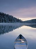 Canoe on Winchell Lake after first snowfall, Alberta, Canada. - Stock Image - CFAC1J
