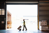 Warehouse Worker Moving Boxes - Stock Image - BK2D96