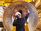 Engineer Inspecting Turbine - Stock Image - B7KE15