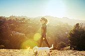 USA, California, Los Angeles, Woman walking dog - Stock Image - DT0KME