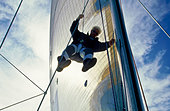Bow man roping down from mast - Stock Image - C5TN2A