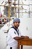Aarhus, Denmark. 4th July, 2013. Crew member at The Royal Navy of Oman vessel Shabab Oman, during The Tall Ships Races 2013 in Aarhus, Denmark.  The city of Aarhus in Denmark, is the starting point of this years Tall Ships Races. The event includes a fleet of 104 sailing vessels and 3000 crew members from all over the world. © Michael Harder/Alamy Live News - Stock Image - DA5TY0
