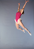trapeze artist flying through the air grey background - Stock Image - A3F6E3