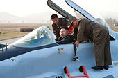 Pyongyang. 30th Oct, 2014. The undated photo provided by Korean Central News Agency (KCNA) on Oct. 30, 2014 shows top leader of the Democratic People's Republic of Korea (DPRK) Kim Jong Un (C) boarding a plane when he oversees a flight drill by the Korean People's Army (KPA). Top leader of the Democratic People's Republic of Korea (DPRK) Kim Jong Un has overseen a flight drill by the Korean People's Army (KPA), the official KCNA news agency reported Thursday. © KCNA/Xinhua/Alamy Live News - Stock Image - E9N4H6