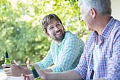Father and son drinking outdoors - Stock Image - E777TE