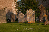 Old headstones in church graveyard - Stock Image - C57EAG