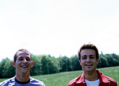 portrait of gay couple outdoors looking at camera - Stock Image - AAY56B