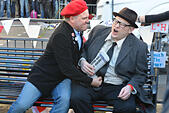 Hammersmith, London, UK. 14th November 2014. Two look a likes on the new bench to Rik Mayall. A bench in memory of the late comedian Rik Mayall  and star  of The Young Ones and Bottom is unveiled in Hammersmith. © Matthew Chattle/Alamy Live News - Stock Image - EAG24E