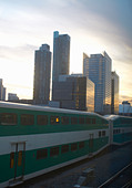Train passing by Toronto city skyline - Stock Image - CRC5MG