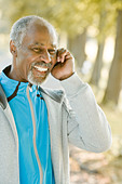 Senior man using a mobile phone, Sweden. - Stock Image - BHH4W2