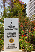 CTO tourist information sign with blossom, Larnaca, Cyprus. - Stock Image - E15MNW