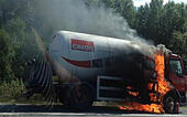 Manchester, UK. 10th Aug, 2015. M56 /Chester Manchester Monday 10th August 2015  A blazing tanker on the Chester bound carriageway of the M56 has closed the motorway in both directions.  The lorry is on the hard shoulder between J14 at Hapsford and Junction 15 at the M53 and a 1500 metres cordon has been set up.  Motorists within it are being evacuated from their vehicles and being moved to a safe distance.  Traffic is reportedly backed up from Daresbury and at a stand still. © jason kay/Alamy Live News - Stock Image - F0904N