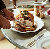 Stuffed roast pork being carved - Stock Image - BJK1N2