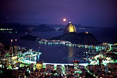 Sugar Loaf Mountain and Botafogo inlet Rio de Janeiro skyline at night with moon Brazil - Stock Image - AAM6T7