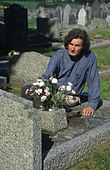 man in a graveyard - Stock Image - AKAD7G