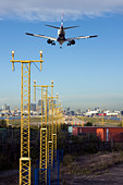 British Airways regional airliner landing at London City Airport, England, UK - Stock Image - CYHHTJ