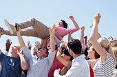 Man crowd surfing - Stock Image - CWJN11
