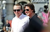 epa04857905 US actor/cast member Tom Cruise (R) and British actor/cast member Simon Pegg (L) smile on the red carpet ahead of the world premiere of 'Mission: Impossible - Rogue Nation' in front of the Vienna State Opera, in Vienna, Austria, 23 July 2015. The fifth installment in the Mission: Impossible movie series opens in Austrian theaters on 06 August.  EPA/HERBERT NEUBAUER - Stock Image - EYBKGJ