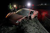Santiago, Chile. 16th June, 2015. Security personnel is seen at the site where a vehicle, belonging to Arturo Vidal of Chile's National Soccer Team, remains crashed, at 25 kilometers of the south access to Santiago, Chile, on June 16, 2015. According to local press, Vidal, suffered a car accident on his way to the concentration of his team. He and his wife, who was with him during the accident, are reported with minor injuries, however the player was movet to an hospital for a medical check. © Felipe Fredes/AGENCIAUNO/Xinhua/Alamy Live News - Stock Image - EW30R8