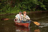 two young boys in a canoe - Stock Image - A628FX