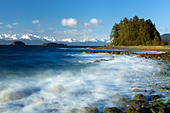 COMPOSITE: Wind and waves pound the rocky coastline along Eagle Beach, Lynn Canal, Inside Passage, Alaska - Stock Image - CNB3AF