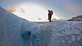 Man walking on glacier - Stock Image - C83CWT