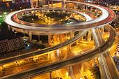 Traffic on roundabout leading to Nanpu bridge at dusk; Dongjiadu: Shanghai; China - Stock Image - C79EJ4