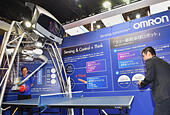 Makuhari, Japan. 7th Sep, 2014. Omron's ping-pong playing robot demonstrates its ability in a match against a visitor at CEATEC, Asia's largest IT and electronics trade show opened in Makuhari, east of Tokyo, on Tuesday, September 7, 2014. CEATEC, short for Combined Exhibition of Advanced Technologies, provides a platform for companies and organizations from all over the world to showcase their cutting-edge products, services and technologies. © Natsuki Sakai/AFLO/Alamy Live News - Stock Image - E8EXTN