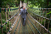 Britain's Prince Charles , The Prince of Wales, crosses the longest rope bridge in the UK at The Lost Garden's of Heligan near Mevagissey in Cornwall - Stock Image - EY7ANF