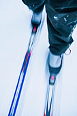 Low section of a person cross-country skiing - Stock Image - CMW0HY