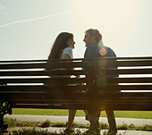 Intimate Couple on Bench - Stock Image - CX6KA0